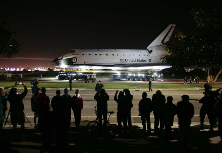 Spectators watch as space shuttle Endeavour leaves Los Angeles International Airport and is transported on city streets to the California Science Center in Los Angeles, Californi. (Jason Redmond/Reuters photo)