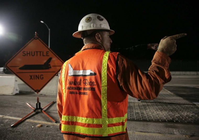 Workers prepare Lincoln Boulevard outside Los Angeles International Airport as roads are closed to move space shuttle Endeavour to the California Science Center in Los Angeles. (ason Redmond/Reuters photo)