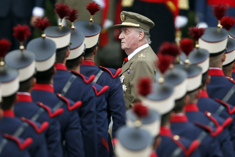 Spain's King Juan Carlos reviews the troops during a military parade marking Spain's National Day in Madrid. (Juan Medina/Reuters)