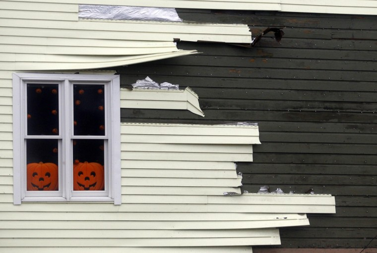 Siding blows off of a house along the coast due to high winds from Hurricane Sandy in Scituate, Massachusetts. (Jessica Rinaldi/Reuters)