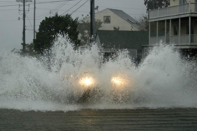 An emergency vehicle plows through flood water as Hurricane Sandy comes ashore in Dewey Beach, Delaware(Jonathan Ernst/Reuters)
