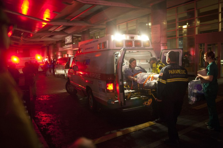 Paramedics evacuate patients from New York University Tisch Hospital due to a power outage as Hurricane Sandy makes its approach in New York. More than 5.5 million people were left without electrical power by the storm, which crashed ashore late on Monday near the gambling resort of Atlantic City, New Jersey. (Andrew Kelly/Reuters)