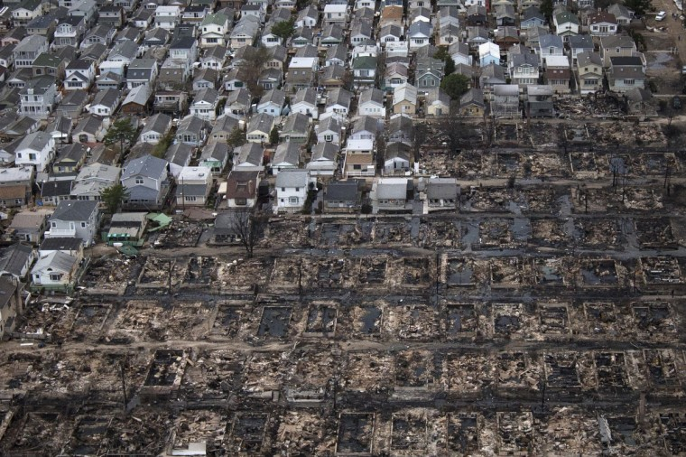Burnt houses are seen next to those which survived in Breezy Point, a neighborhood located in the New York City borough of Queens, after it was devastated by Hurricane Sandy. (Adrees Latif/Reuters)