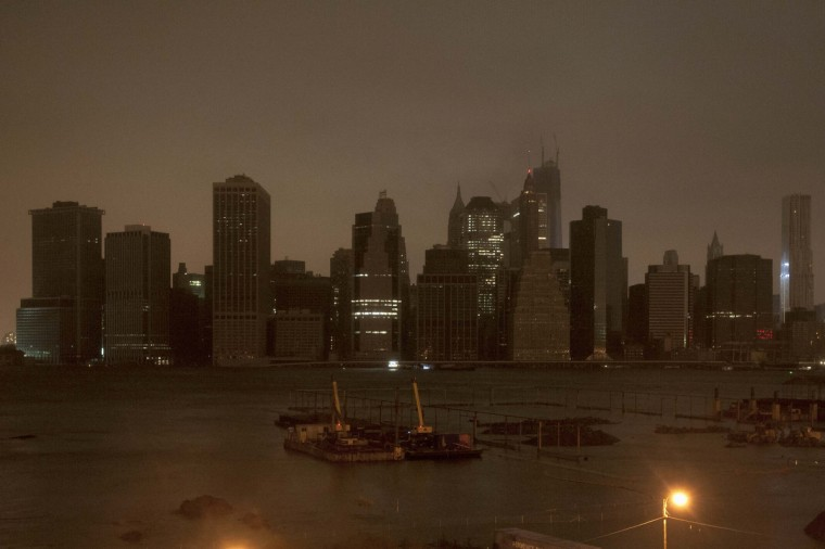 The skyline of lower Manhattan sits in darkness after a preventive power outage in New York. Hurricane Sandy could be the biggest storm to hit the United States mainland when it comes ashore on Monday night, bringing strong winds and dangerous flooding to the East Coast from the mid-Atlantic states to New England, forecasters said on Sunday. (Keith Bedford/Reuters)