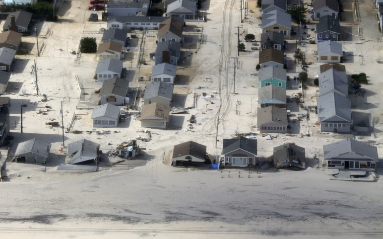 Homes are surrounded by sand washed in by Superstorm Sandy in Ocean County, New Jersey. (Doug Mills/Getty Images)