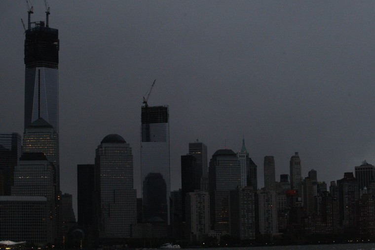 October 30, 2012: A general view from Exchange Place, New Jersey, shows the skyline of lower Manhattan in darkness after a preventive power outage caused by giant storm Sandy in New York. (Eduardo Munoz/Reuters)