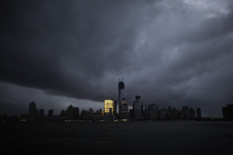 October 30, 2012: A general view from Exchange Place shows the skyline of lower Manhattan in darkness after a preventive power outage caused by giant storm Sandy in New York. (Eduardo Munoz/Reuters)