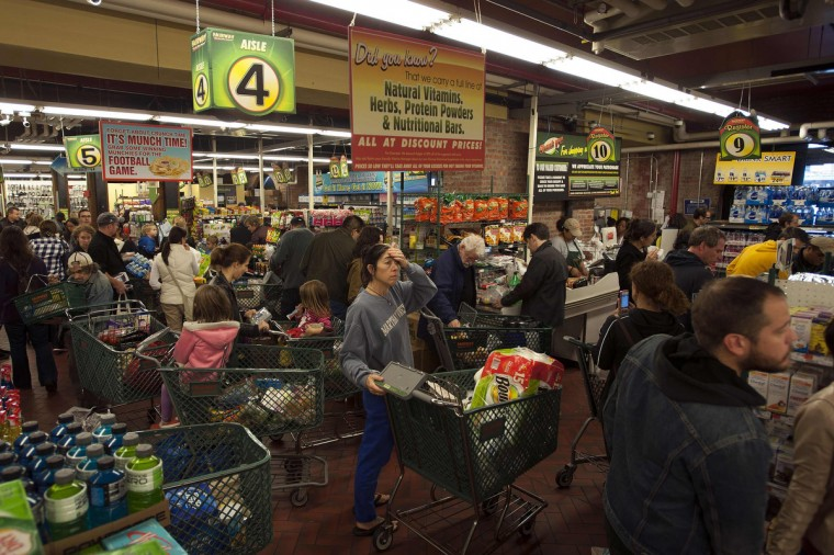 Customers wait in line to buy groceries at the Fairway super market in New York. Hurricane Sandy could be the biggest storm to hit the United States mainland when it comes ashore on Monday night, bringing strong winds and dangerous flooding to the East Coast from the mid-Atlantic states to New England, forecasters said on Sunday. (Keith Bedford/Reuters)