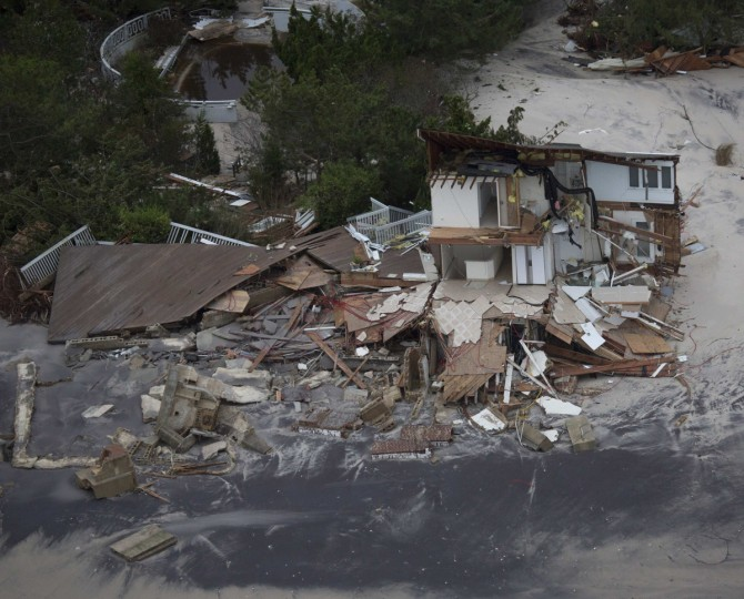 Damaged houses covered in sand in Lavallette, New Jersey are seen in an aerial view of Hurricane Sandy damage. (Tim Aubry/Greenpeace)