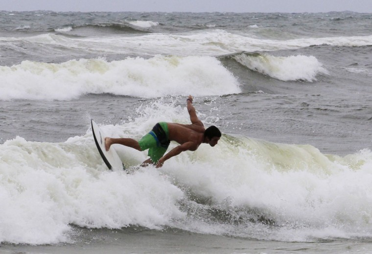 October 25, 2012: A surfer takes advantage of higher waves as winds from Hurricane Sandy began to affect weather in Boca Raton, Florida. (Joe Skipper/Reuters)