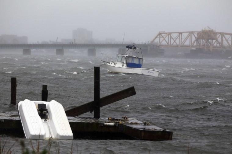 A boat is seen in the rough waters near the Beach Channel section of the Queens borough of New York. Hurricane Sandy, the monster storm bearing down on the East Coast, strengthened on Monday after hundreds of thousands moved to higher ground, public transport shut down and the stock market suffered its first weather-related closure in 27 years. (Shannon Stapleton/Reuters)