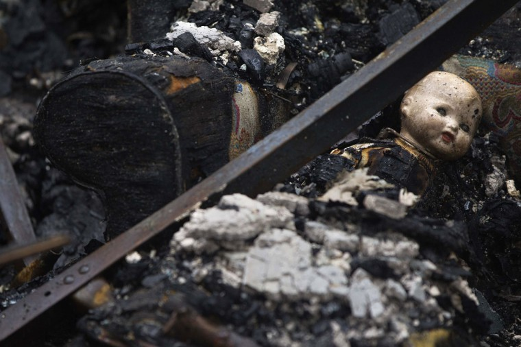 October 30, 2012: A doll is seen inside a home devastated by fire in the aftermath of Hurricane Sandy in the Breezy Point section of the Queens borough of New York. (Shannon Stapleton/Reuters)