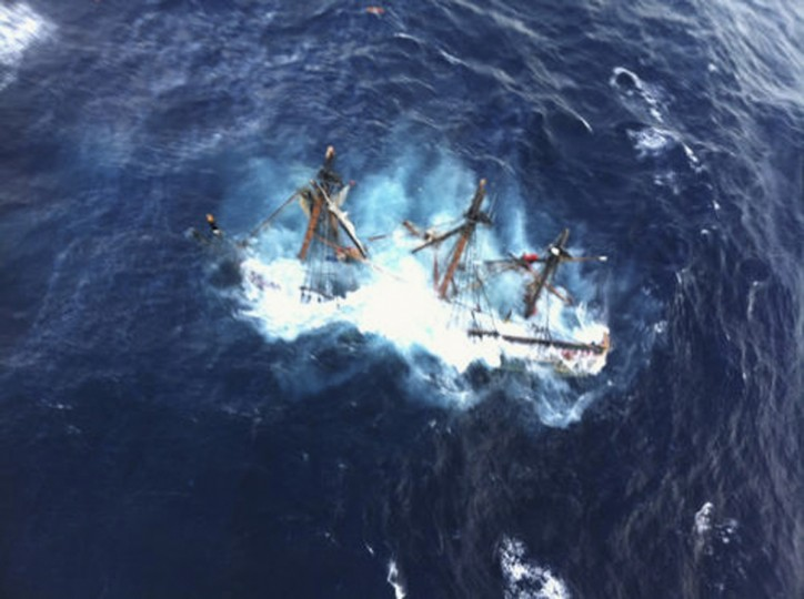 The HMS Bounty, a 180-foot sailboat, is shown submerged in the Atlantic Ocean during Hurricane Sandy approximately 90 miles (145 km) southeast of Hatteras, North Carolina. Of the 16-person crew, the Coast Guard rescued 14, recovered a woman and is searching for the captain of the vessel. (Petty Officer 2nd Class Tim Kuklewski/USCG)