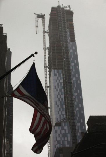 October 29, 2012: A crane hangs from a building after being damaged in winds from Hurricane Sandy in New York. (Brendan McDermid/Reuters)