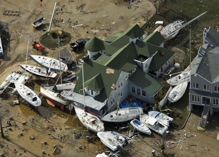 Boats are piled next to a house, where they were washed ashore during Hurricane Sandy, near Monmouth Beach, New Jersey. (Steve Nesius/Reuters)