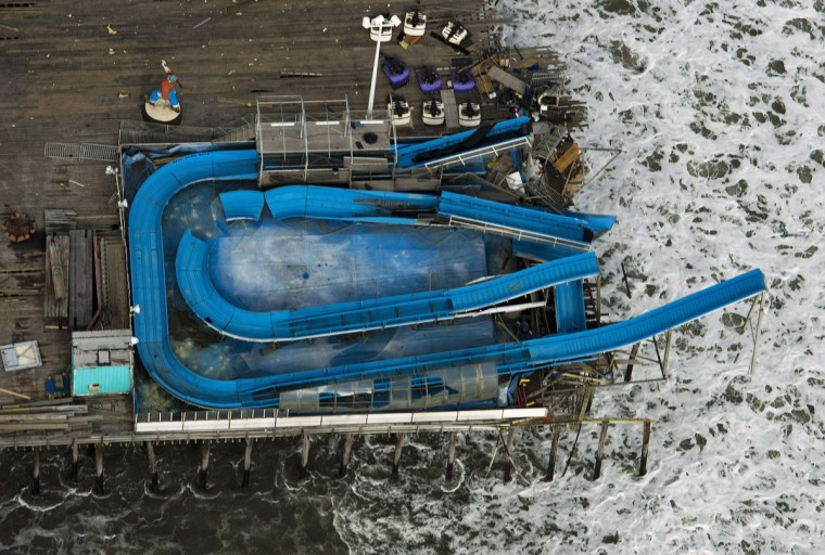 A water slide hangs over the end of an amusement park's pier, partially destroyed from Hurricane Sandy, in Seaside Park, New Jersey. (Steve Nesius/Reuters)