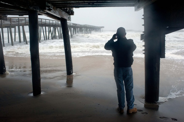 A beachgoer along the oceanfront observes the effects of high wind and heavy rain as Hurricane Sandy begins to arrive in Virginia Beach, Virginia. Sandy is expected to make landfall on the Eastern Seaboard near New Jersey October 30, bringing strong winds and dangerous flooding to the East Coast from the mid-Atlantic states to New England. (Rich-Joseph Facun/Reuters)
