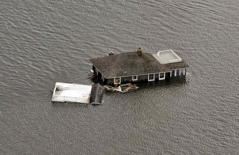 A house floats in the bay after it was washed from its foundation during Hurricane Sandy in Manotoloking, New Jersey. (Steve Nesius/Reuters)