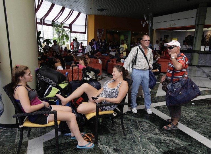 Tourists wait at a hotel lobby to leave Santiago de Cuba. (Desmond Boylan/Reuters)
