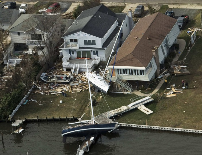 Sailboats are seen washed up behind several homes following Hurricane Sandy in Monmouth Beach, New Jersey. (Steve Nesius/Reuters)