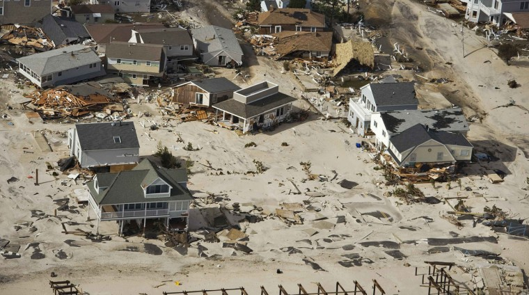 Houses washed away by the tidal surge during Hurricane Sandy are seen among several beach homes still standing, in Seaside Heights, New Jersey. (Steve Nesius/Reuters)