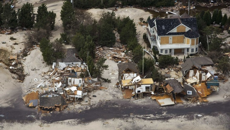 A lone house stands on the shoreline among destroyed homes after Hurricane Sandy came ashore in Lavallette, New Jersey. (Steve Nesius)