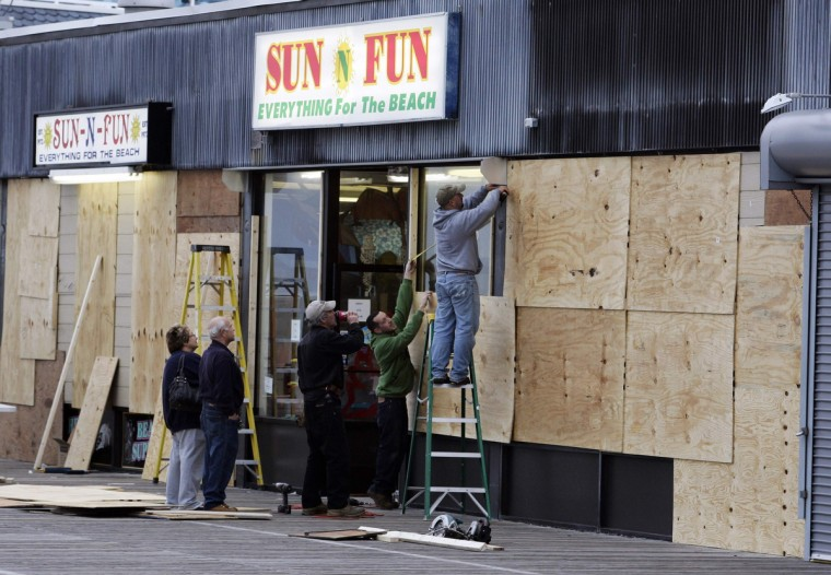 A crew works to board-up a business against Hurricane Sandy in Ocean City, New Jersey. The popular boardwalk in this resort town has dozens of business facing the ocean and expected to get the full brunt of the storm when it hits land sometime Monday. (Tom Mihalek/Reuters)