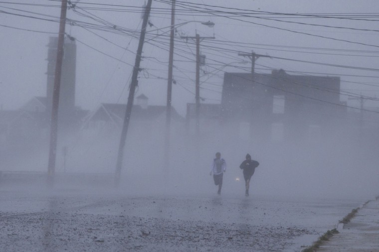 Two boys run down Foster Avenue while dodging high winds and waves from the effects of Hurricane Sandy in Marshfield, Massachusetts. (Scott Eisen/Reuters)