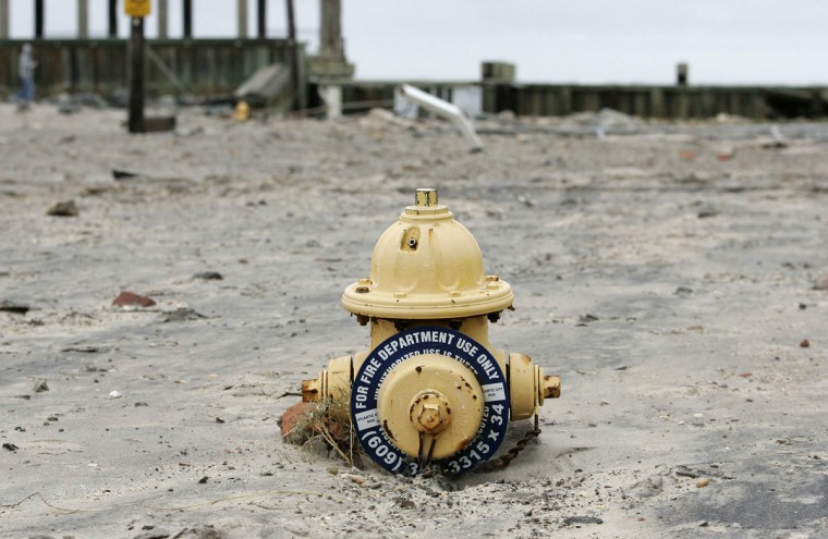 October 30, 2012: A fire hydrant nearly covered with sand washed ashore is seen in the aftermath of Hurricane Sandy in Atlantic City, New Jersey. (Tom Mihalek/Reuters)
