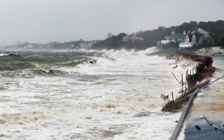 October 29, 2012: The storm surge from Hurricane Sandy breaks against a beach below homes in Shinnecock Hills, New York. (Lucas Jackson/Reuters)