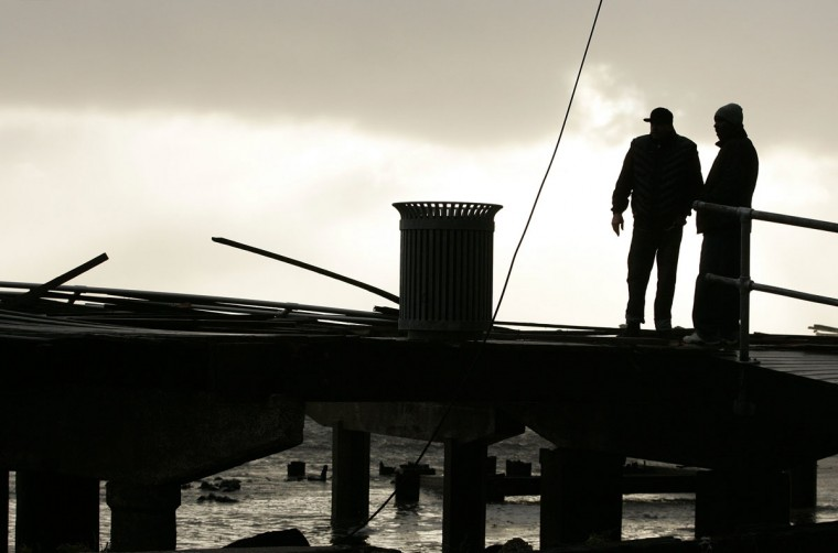 October 30, 2012: Two men look at the demolished section of a boardwalk at the end of Pacific Avenue in the north end of the city, in the aftermath of Hurricane Sandy's landfall in Atlantic City, New Jersey. (Tom Mihalek/Reuters)