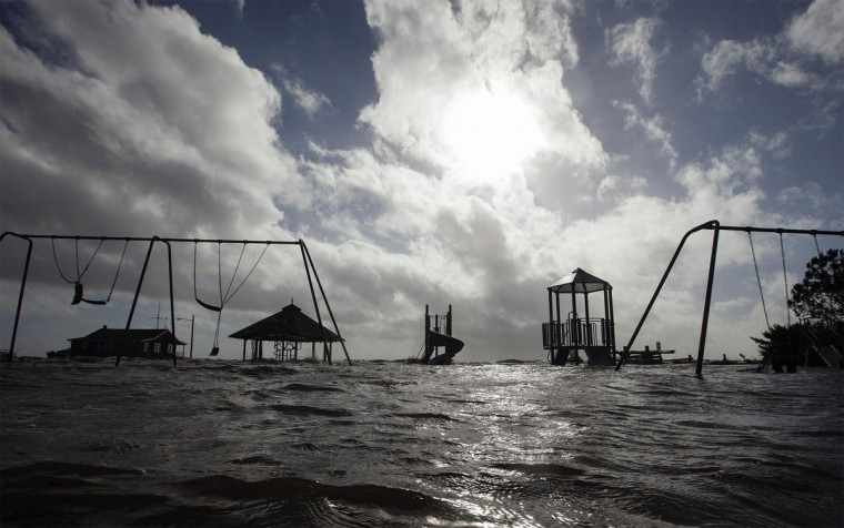 October 30, 2012: A playground stands surrounded by water pushed up by Hurricane Sandy in Bellport, New York. (Lucas Jackson/Reuters)
