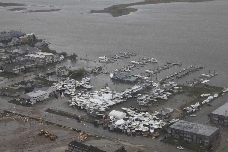 October 30, 2012: Damage after Hurricane Sandy made landfall on the southern New Jersey coastline is seen in this U.S. Coast Guard handout photo in Brigantine, New Jersey. (U.S.Coast Guard/Petty Officer 2nd Class Erik Swanson/Handout/Reuters)