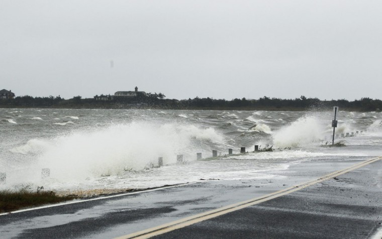 October 29, 2012: Waves crest over a road by wind pushed in by Hurricane Sandy in Southampton, New York. (Lucas Jackson/Reuters)