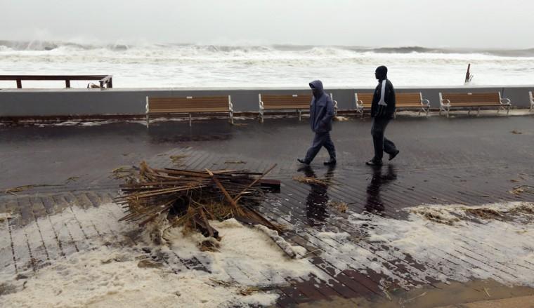 October 29, 2012: A couple walks past debris on the boardwalk in Ocean City, Maryland, as Hurricane Sandy intensifies. (Kevin Lamarque/Reuters)