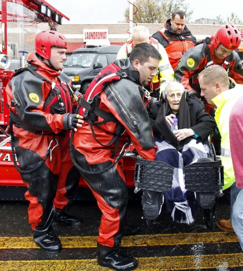 October 30, 2012: Rescue workers carry a wheelchair-bound resident from flood waters brought on by Hurricane Sandy in Little Ferry, New Jersey. (Adam Hunger/Reuters)