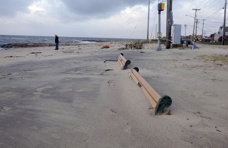 October 30, 2012: High sand levels cover benches on the beach in West Haven, Connecticut after Hurricane Sandy hit the area. (Michelle McLoughlin/Reuters)