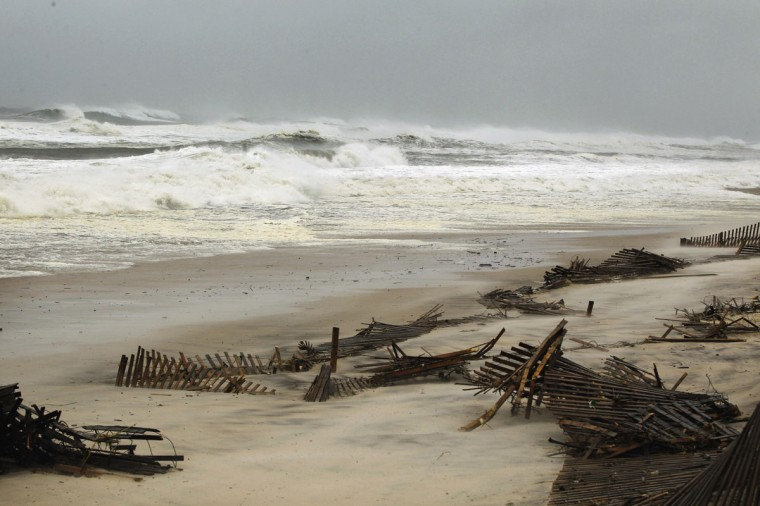 October 29, 2012: Fencing lies on a beach after being ripped down by waves caused by Hurricane Sandy in Southampton, New York. (Lucas Jackson/Reuters)