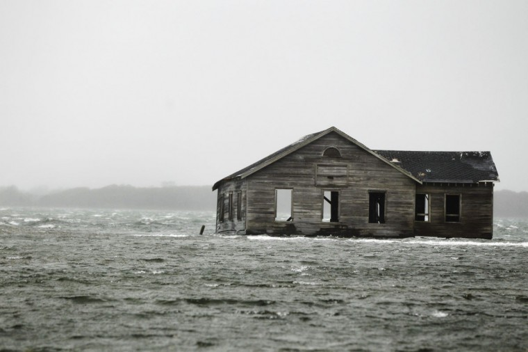 October 29, 2012: An abandoned home is inundated with water at Shinnecock Bay in Southampton, New York. (Lucas Jackson/Reuters)