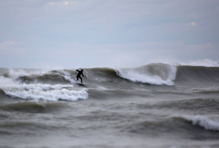 October, 30, 2012: Surfers endure the cold waters as large surf batters the Milwaukee coastline from the long reaching effects from Hurricane Sandy, Milwaukee Wisconsin. (Darren Hauck/Reuters)