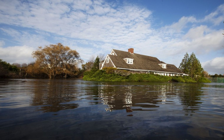 October 30, 2012: Homes are surrounded by floodwaters pushed up by high tide and the storm surge from Hurricane Sandy in Westhampton Beach, New York. (Lucas Jackson/Reuters)
