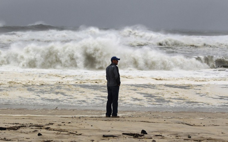 October 29, 2012: A man stands on the beach to watch the storm surf, kicked up ahead of Hurricane Sandy, in Southampton, New York. (Lucas Jackson/Reuters)