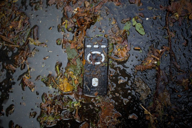 October 30, 2012: A remote control lies partially submerged in water on 14th street of Manhattan after the storms from last night's Hurricane Sandy in New York. (Andrew Kelly/Reuters)