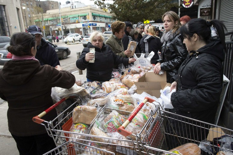 People buy food from a temporary street market in the Brighton Beach neighborhood of New York October 31, 2012. (Andrew Kelly/Reuters)