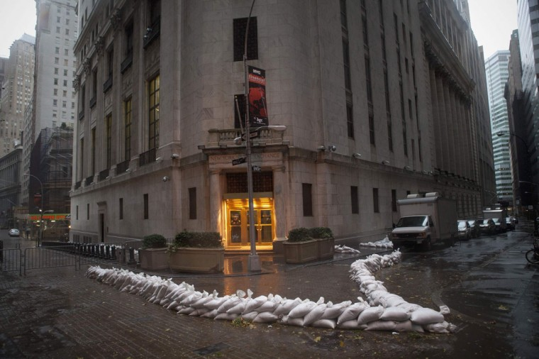 October 29, 2012: Sandbags block the entrance of the New York Stock Exchange in downtown Manhattan as Hurricane Sandy made its approach in New York. (Andrew Kelly/Reuters)