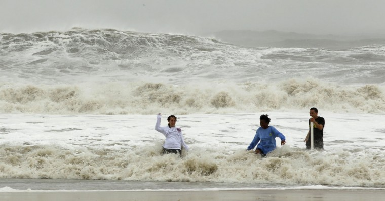 October 29, 2012: Residents take a dip in the big surf in Ocean City, Maryland, as Hurricane Sandy intensifies. (Kevin Lamarque/Reuters)