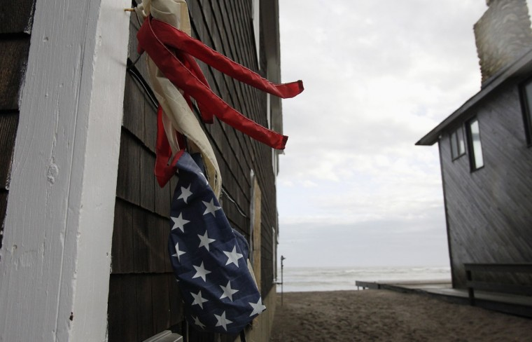 October 30, 2012: An American Flag windsock is wrapped around the side of a building as clean up begins from Hurricane Sandy in Scituate, Massachusetts. (Jessica Rinaldi/Reuters)