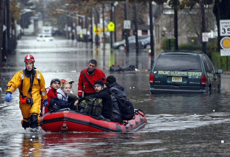 October 30, 2012: Emergency personnel rescue residents from flood waters brought on by Hurricane Sandy in Little Ferry, New Jersey. (Adam Hunger/Reuters)