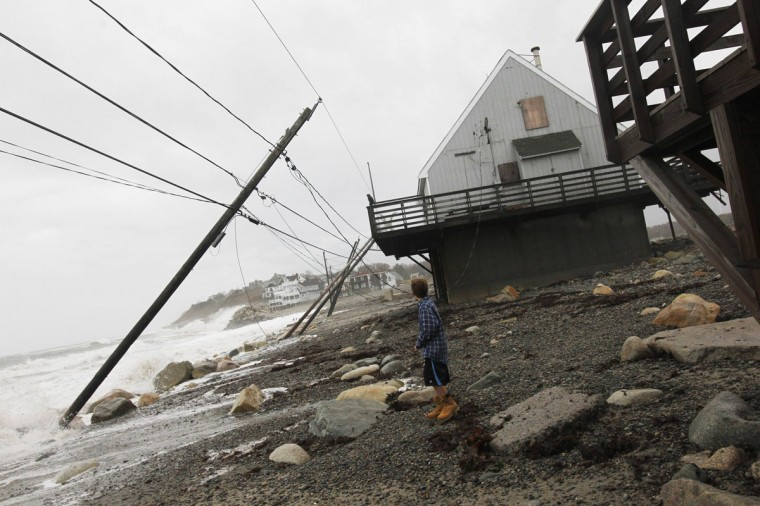 October 30, 2012: Trent Risley, 11, looks at power lines knocked down by Hurricane Sandy in Scituate, Massachusetts. (Jessica Rinaldi/Reuters)