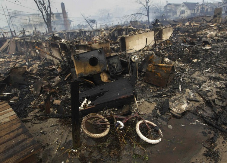 October 30, 2012: A view shows homes devastated by fire and the effects of Hurricane Sandy at the Breezy Point section of the Queens borough of New York. (Shannon Stapleton/Reuters)